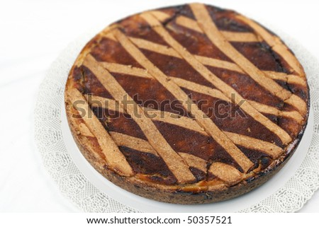a slice of Pastiera: a pie of ricotta cheese and grain which is prepared during easter times in Naples, Italy. - stock photo