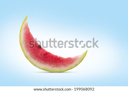 A slice of watermelon in a shape of moon - stock photo