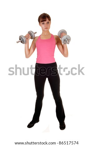 A slim teenage girl with dumbbells doing some weight lifting in the studio as exercise to stay fit, for white background.
