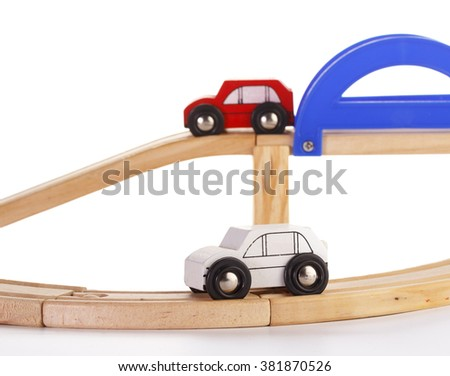 A slot wooden cars race set on a track over white background - stock photo