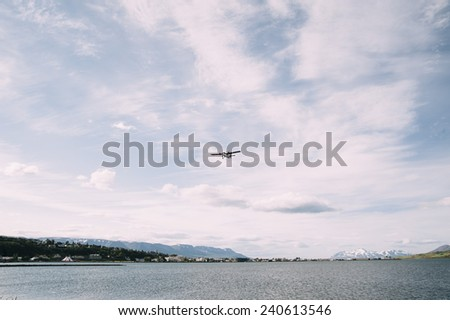 a small air plane landing in the north Icelandic Airport - stock photo