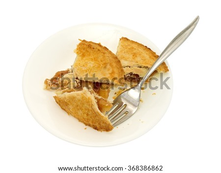 A small apple pie in pieces on a plate with fork isolated on a white background. - stock photo
