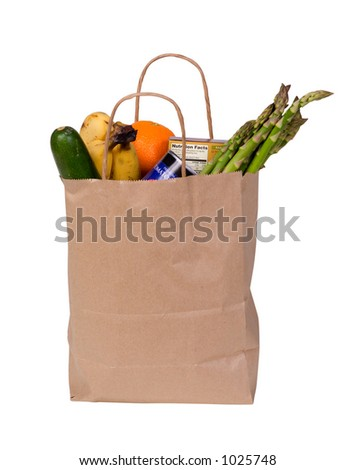 A small bag of groceries isolated on white with clipping path outline. - stock photo