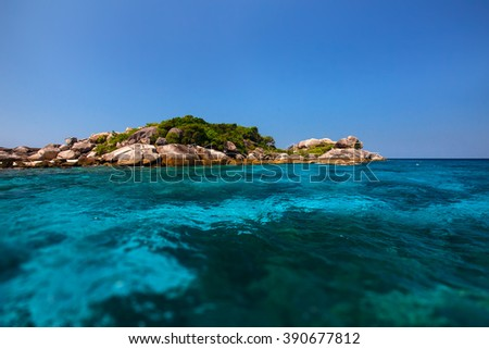 a small beautiful tropical island with clear turquoise water. Similan Islands, Thailand - stock photo