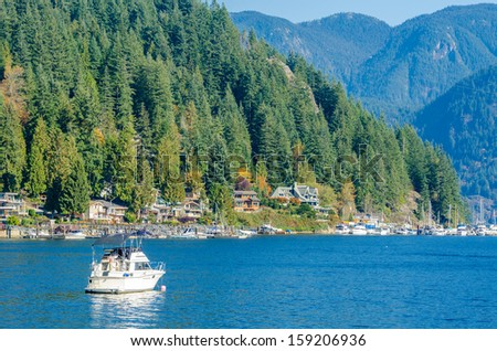 A small boat in front of the beautiful city of Vancouver, Canada. - stock photo