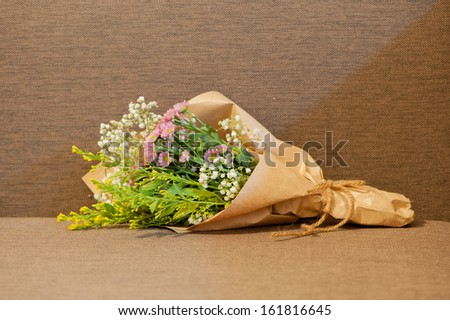 Flower bouquet brown paper demirediffusion small bouquet beautiful flowers kraft paper stock photo download mightylinksfo