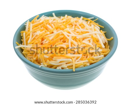 A small bowl filled with shredded white cheddar, sharp cheddar and mild cheddar cheeses isolated on a white background. - stock photo