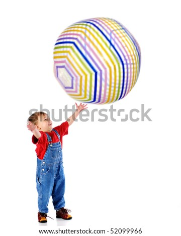 A small boy happily catching a giant beach-ball.  Ball and boy's hands with motion blur.  Isolated on white. - stock photo