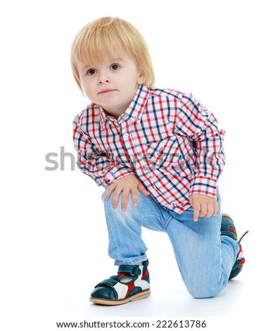A small boy in the studio.Childhood education development in the Montessori school concept. Isolated on white background. - stock photo