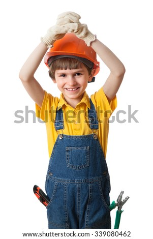 a small boy with hardhat and hands above head - stock photo