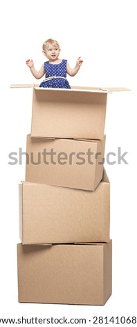 A small child in cardboard boxes on white background