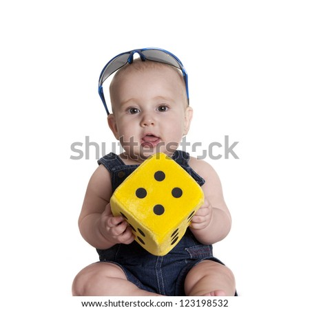 a small child playing with a toy given - stock photo