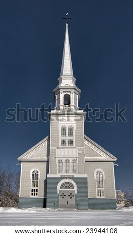 A small church in winter - stock photo