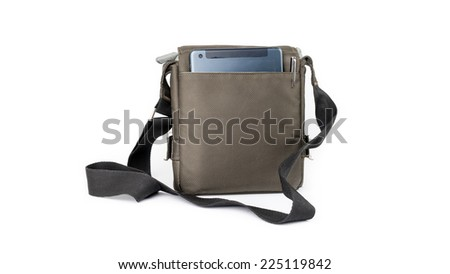 A small dark green sling bag with a modern tablet device and pen on the back. Isolated on white background. - stock photo