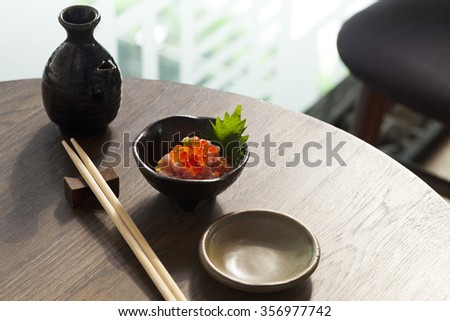 a small dish of Salmon roe and tuna served as an appetizer before the main dish - stock photo