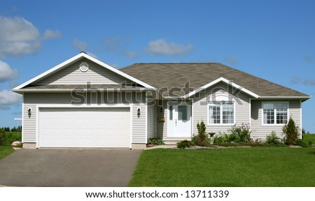 A small family home with garage. - stock photo
