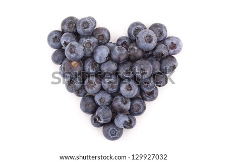 a small heart with blueberries