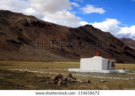 A small Hindu temple in the foreground of Himalaya mountains - stock photo