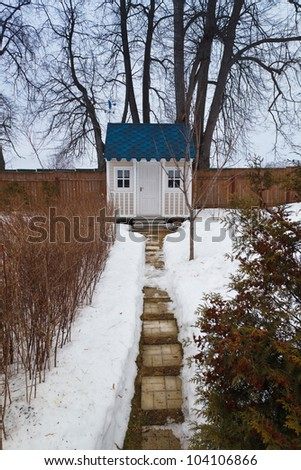 a small house with a footpath
