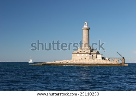 A small island with just a lighthouse on it, 5 nautical miles south-est of Pula, Croatia