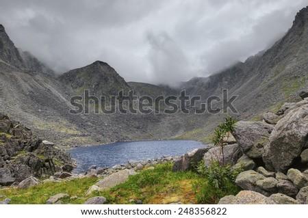 A small lake at the bottom of the mountain basin. Eastern Sayan. Buryatia - stock photo
