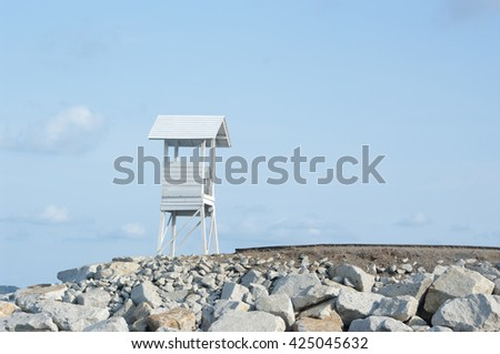 a small lighthouse with a retro  - stock photo