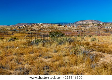 A Small New Mexico Village in the Desert Near the Multi-colored Hills in the North.  - stock photo