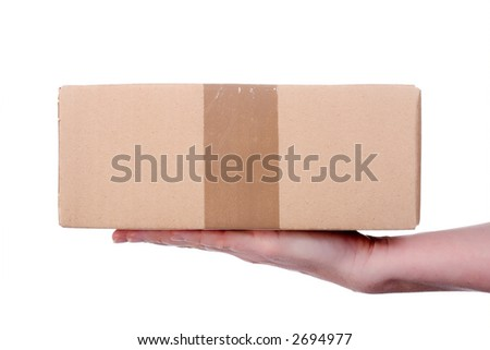 A small parcel, presented on a human hand from the right side. Isolated on white. - stock photo