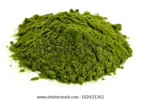 a small pile of green freeze-dried organic wheat grass powder, nutritional supplement - stock photo