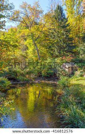 A small pond in early Autumn in Allaire State Park in New Jersey. - stock photo