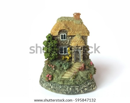 a small  pretty house, toy  isolated on white