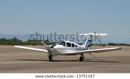 A small prop airplane sits in rural California. - stock photo