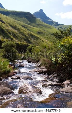 A small, rocky mountain stream in south africa's drakensberg mountain range - stock photo