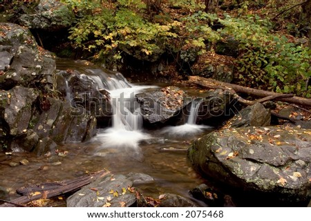 A small secluded cascade in the forests of Virginia. Taken with a slow shutter speed to smooth and soften the water. - stock photo