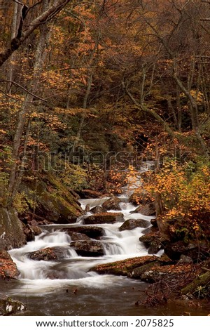 A small secluded cascade in the forests of West Virginia. Taken with a slow shutter speed to smooth and soften the water. - stock photo