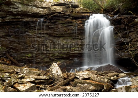 A small secluded waterfall in the forests of West Virginia. - stock photo