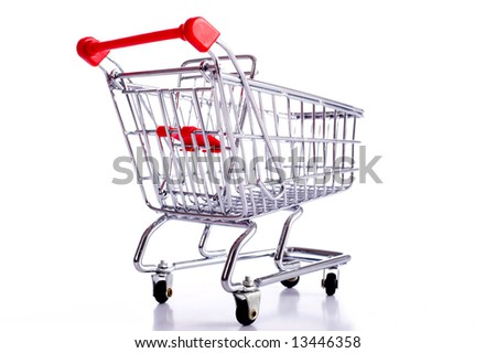 a small shiny shopping cart on a white background with refection
