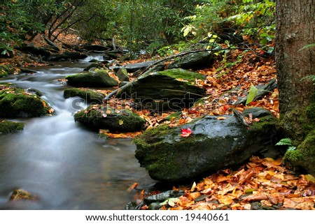 A small stream in VA called Rock Castle Creek during fall of the year. - stock photo