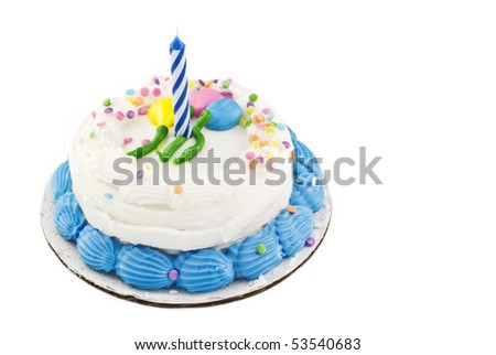 A small white birthday cake with balloon decoration and candy sprinkles, one unlit candle - stock photo