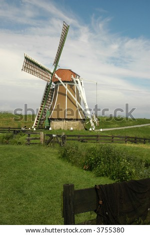 A small windmill near the the IJselmeer in the Netherlands.