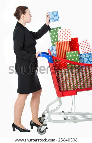 A smartly dressed woman shopping for gifts with a shopping cart - stock photo