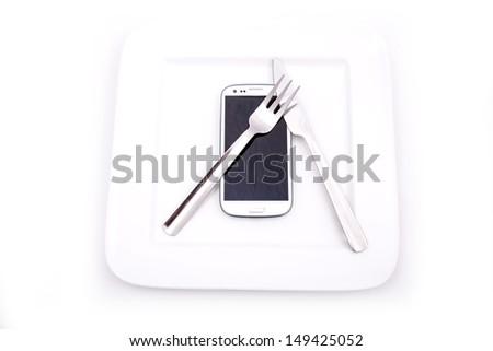 A Smartphone served on a Plate. - stock photo