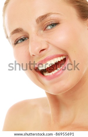 A smile with healthy woman's teeth, isolated on white