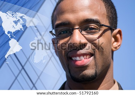 A smiling African American man over a world map conceptual background. - stock photo