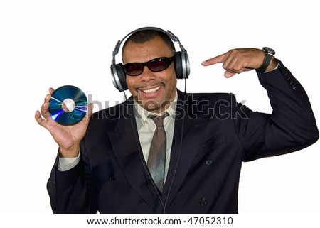 a smiling African-American mature man with sunglasses and headphones pointing at an audio compact disk, isolated on white background - stock photo