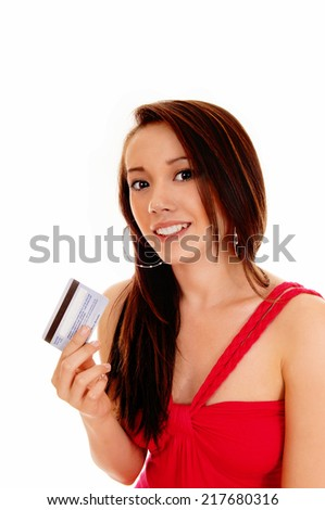 A smiling Asian woman in a red dress holding her credit card, ready for shopping, isolated for white background.  - stock photo