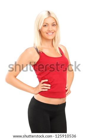 A smiling blond female athlete posing isolated against white background - stock photo