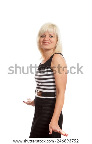 A smiling blond woman wearing a black and white striped dress - stock photo