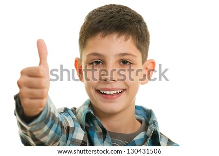 A smiling  boy holding his thumb up on the white background
