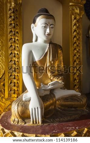 A smiling Buddha in the famous Shwedagon Pagoda, Yangon, Burma, Myanmar, Southeast Asia - stock photo